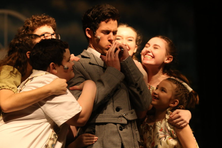 Georg Von Trapp (senior Cole Moore) is surrounded by his children during The Sound of Music by the Methacton Theatre Company