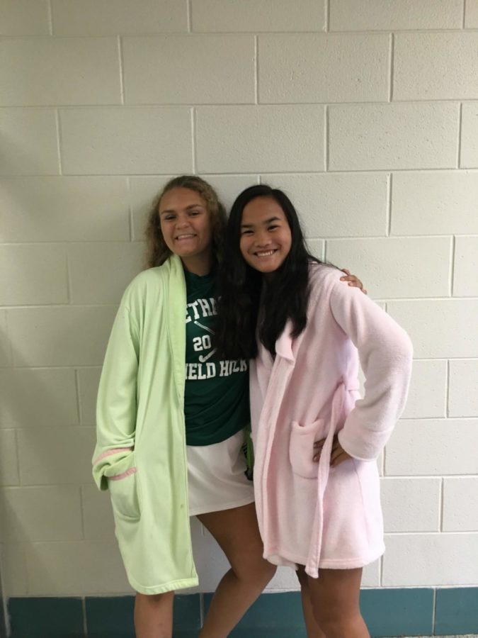(from left) Sophomores Juliette Louer and Ava Probst wear robes for their field hockey game.