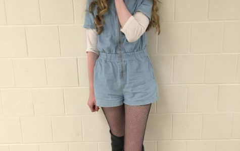 Sophomore Maria Coyle displays a creative style with a jean romper and fishnet leggings.