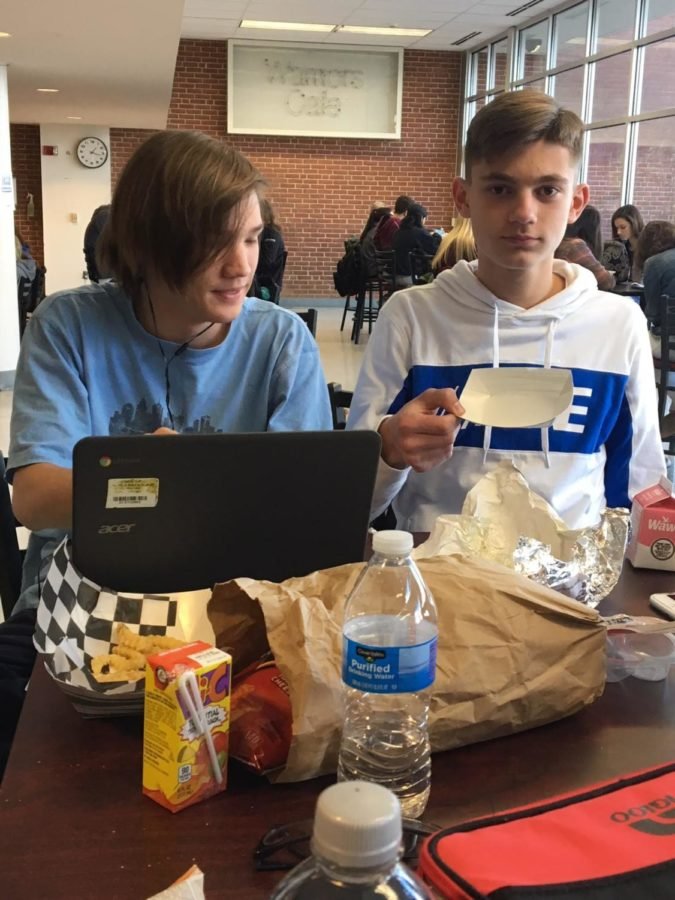 Sitting out in the commons area are (from left) Kevin Robertson and Dakota Messner, both juniors. Kevin loves his fries. Dakota works on his homework.