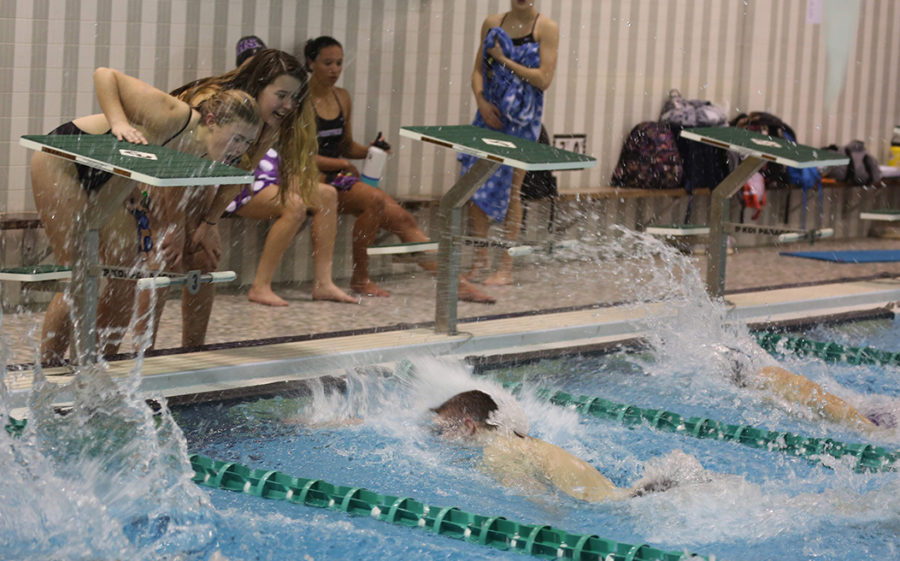 Girls cheer on Jon Groff as he approaches the wall for a very close race finish in the 500 free.