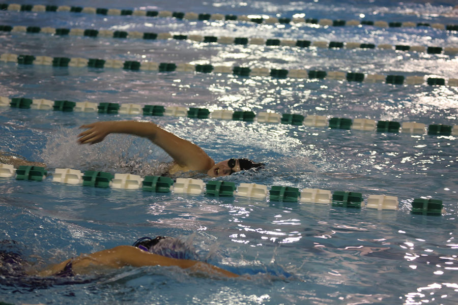 Senior Kaela Boss (far lane) swims the 500 yard freestyle while close to her competitor from Phoenixville.