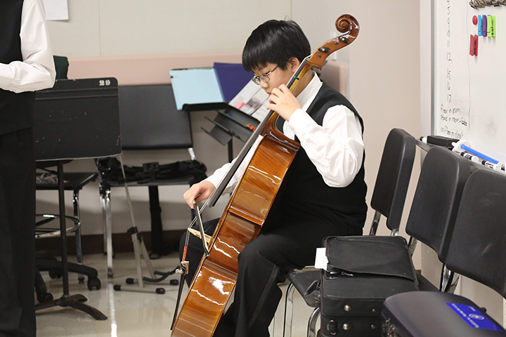 Brandon Park tunes and practices his cello prior to the performance.