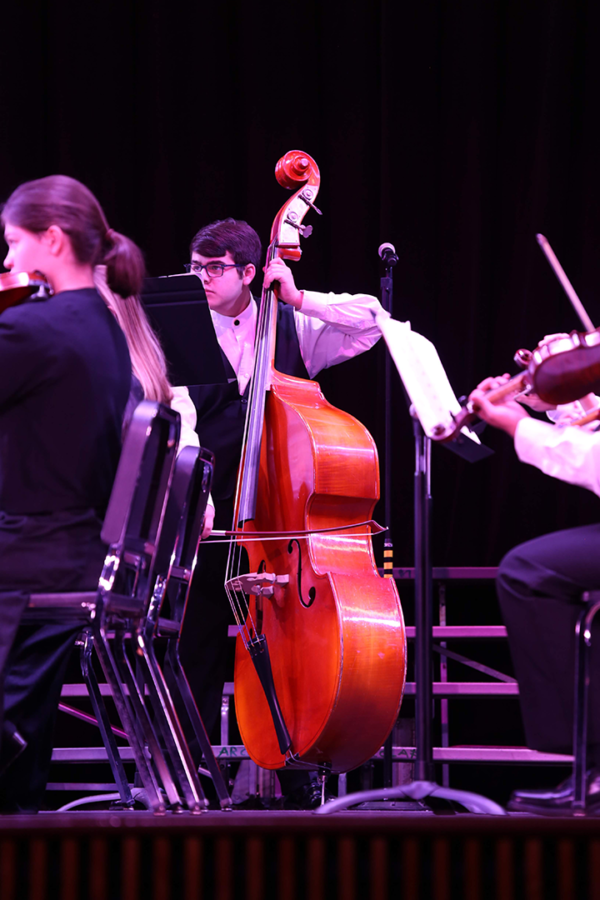 Max Kozol plays the bass during the string orchestra's Chanukah Festival Overture performance.