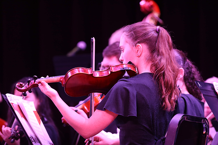 Teresa Otto played violin during Pacem Noel.