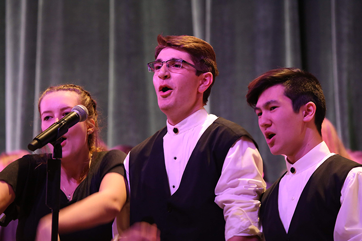(from left) Jocelyn Loehr, Matt Wesztergom, and Evan Henderson sing solos during You're a Mean One, Mr. Grinch.
