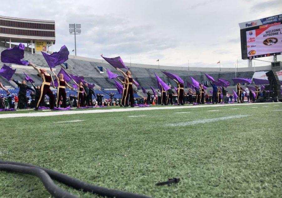 The MHS color guard, along with nine other high school's guards, practiced for the halftime show.