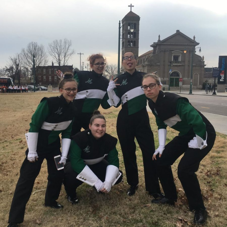 (from left) Olivia Kraynak, Katherine Hoehl, Sarah Rothe, Cassidy Crenshaw and Cecilia Weaver, the flutes gather prior to the parade.