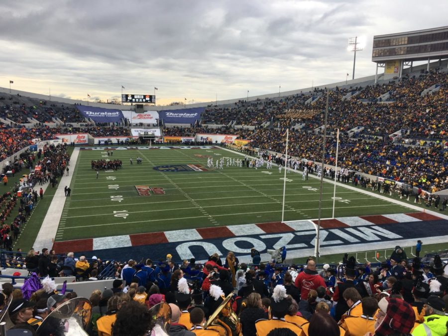 The Warrior Marching Band and Color Guard sat in the University of Missouri's end zone at the Auto Zone Liberty Bowl.