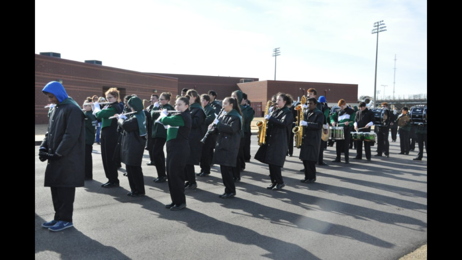 Members of the band get into formation as the parade begins.