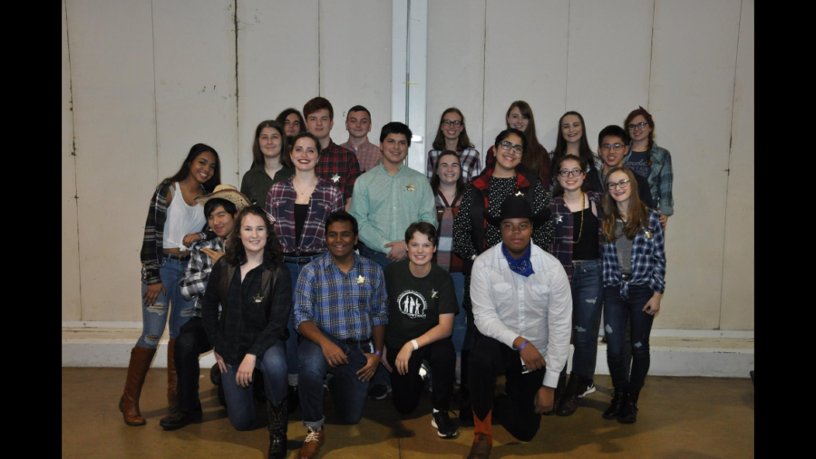 Members+of+the+MHS+woodwinds+gather+for+photograph+at+the+western+themed+dinner+dance.+%0A