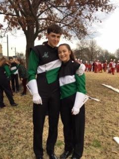 Junior Elizabeth Kirsch and senior Sean Doran pose for a picture before the parade.