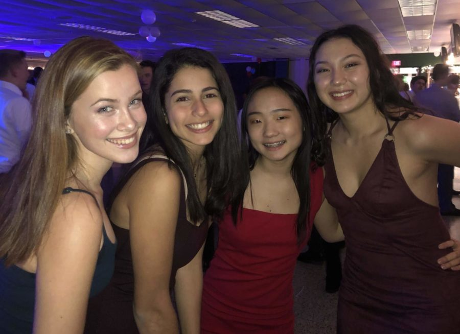 A group of  freshman girls admired the decorations put out in the hallway as they entered the dance.
