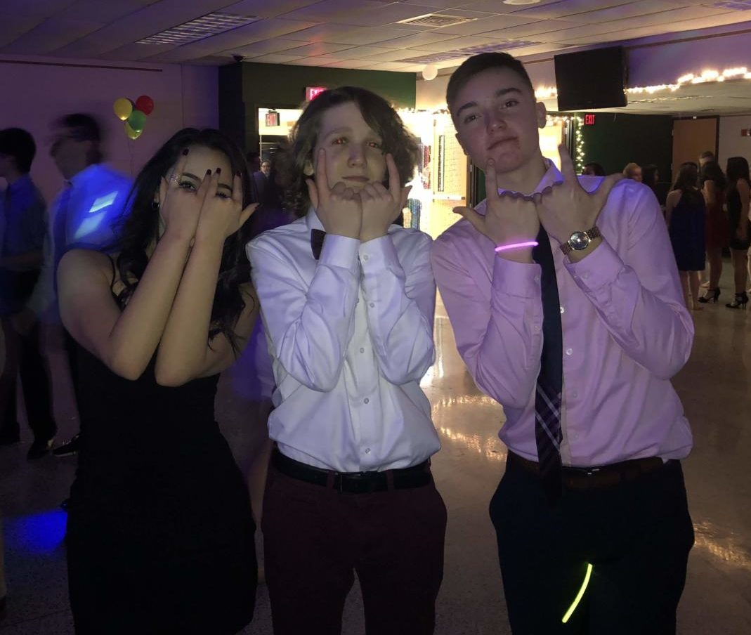 "Danielle Fisher, Frank Calamari and John Ashcom are ready to ""rock and roll"" into the Semi-formal."