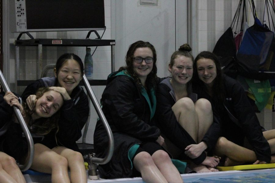(from left) Hailey McGarity, Stephanie Yu, Erin Valle, Kerri Drum and Rachel Prusacki sat poolside to watch their teammates dive.