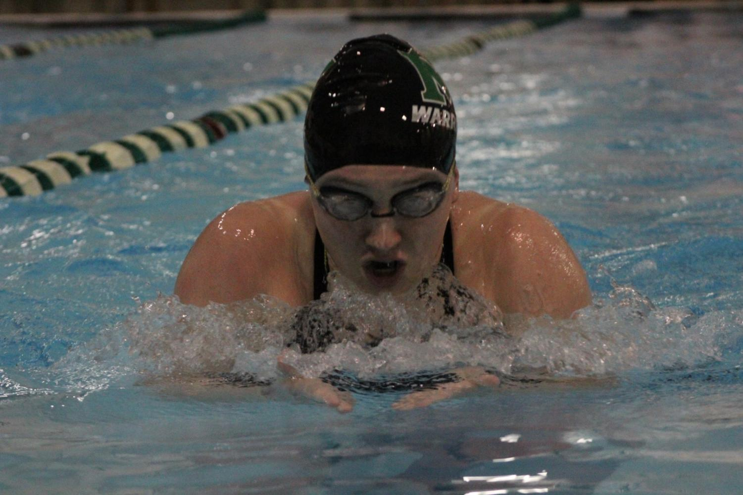 Senior Erin Valle is competed in the 100 breast stroke during her last high school meet at MHS.