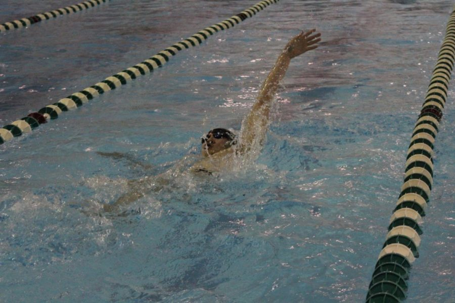 Dylan Phan earned a personal record and second place in 100 backstroke.