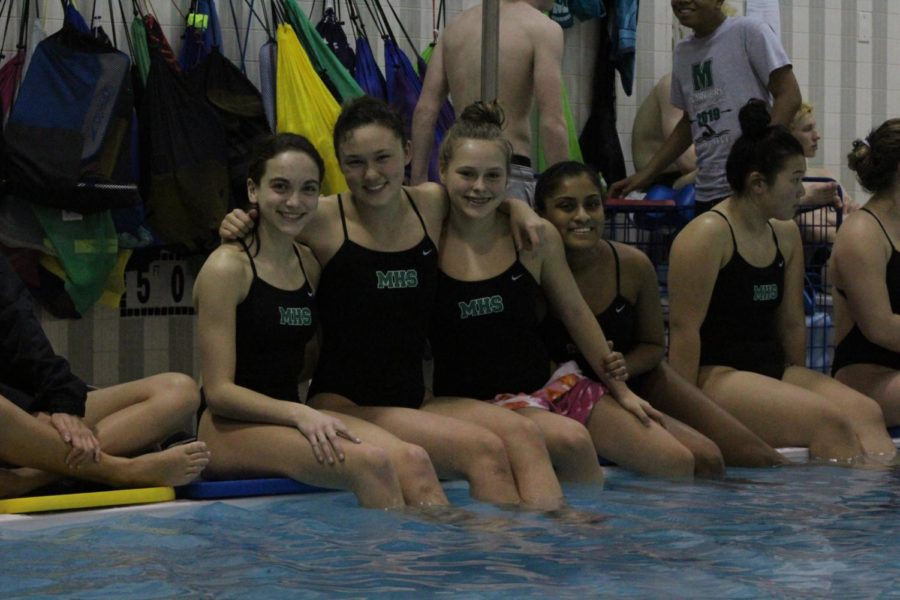 (From left) Hannah Taylor, Alex Ferrance, Sophia Leber and Josephine James rooted for seniors Max Markowitz and Hayden Aubrey during the diving portion of the meet.