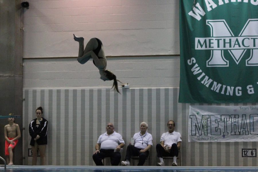 Sophomore Sammie Burstein performed a forward rotation during the diving portion of the match up.