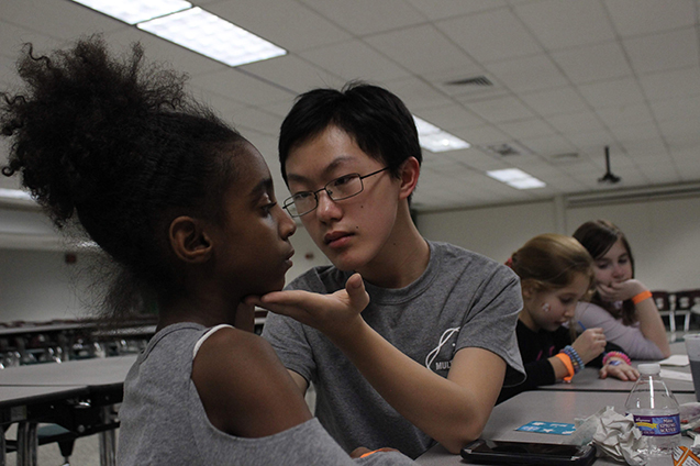 Matt Tang, a freshman, helped out at the face-painting station.