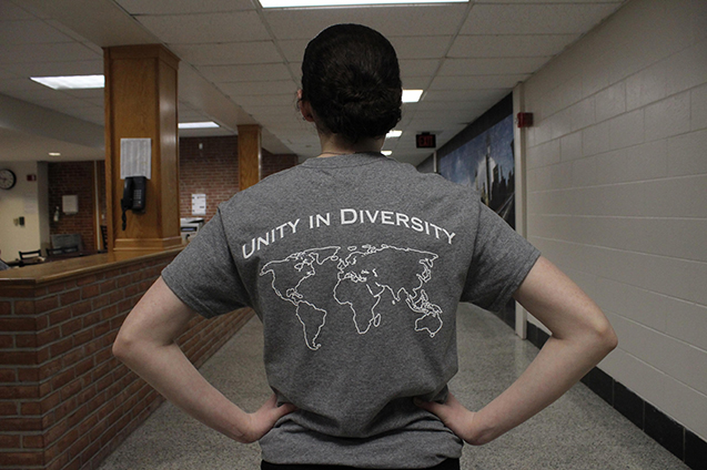 Abby Thornton, freshman, displays one the Multicultural Club shirts worn by club members at the fundraiser.