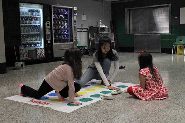 Ashley+Liu%2C+senior+and+club+president%2C+plays+Twister+with+some+of+the+children+participating+in+the+event.%0A