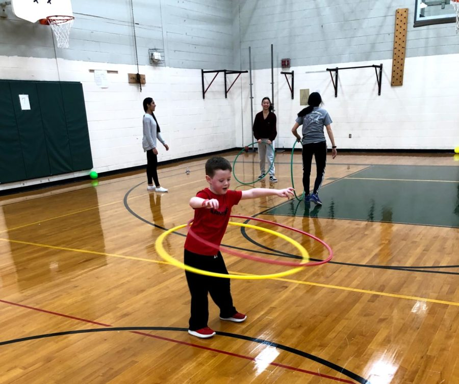 Hula hooping was one of the activities children could participate in while in the boys gymnasium.