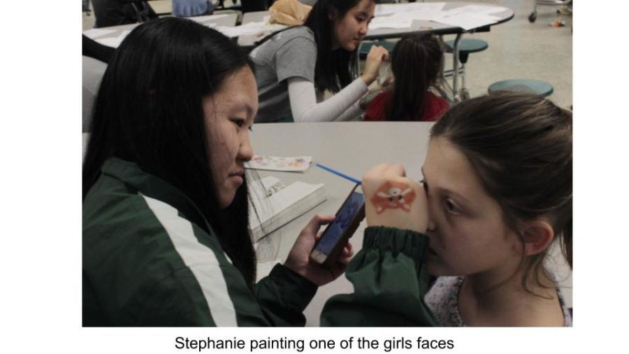 Multi-cultural club member Stephanie was one of the evening's face painters.