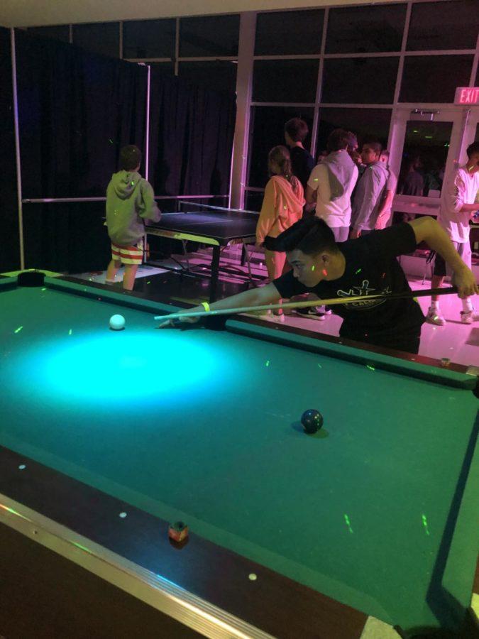 Corey Morabito plays a game of pool.