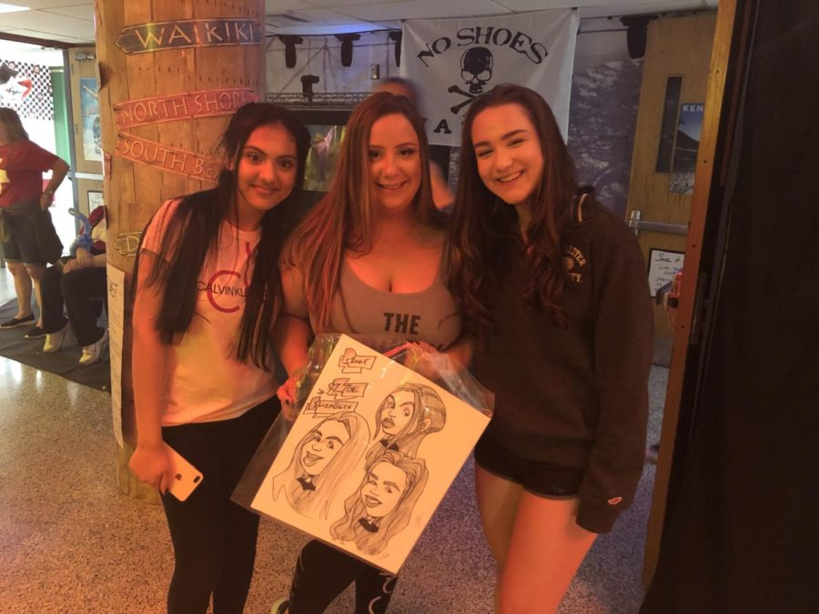 (from left) Preet Boiwala, Zoe LaPaglia and Elizabeth Kirsch show off their caricature.