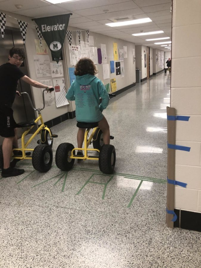 Summer Elsayed and Brendan Ferradji line up at the starting line for their tricycle race.