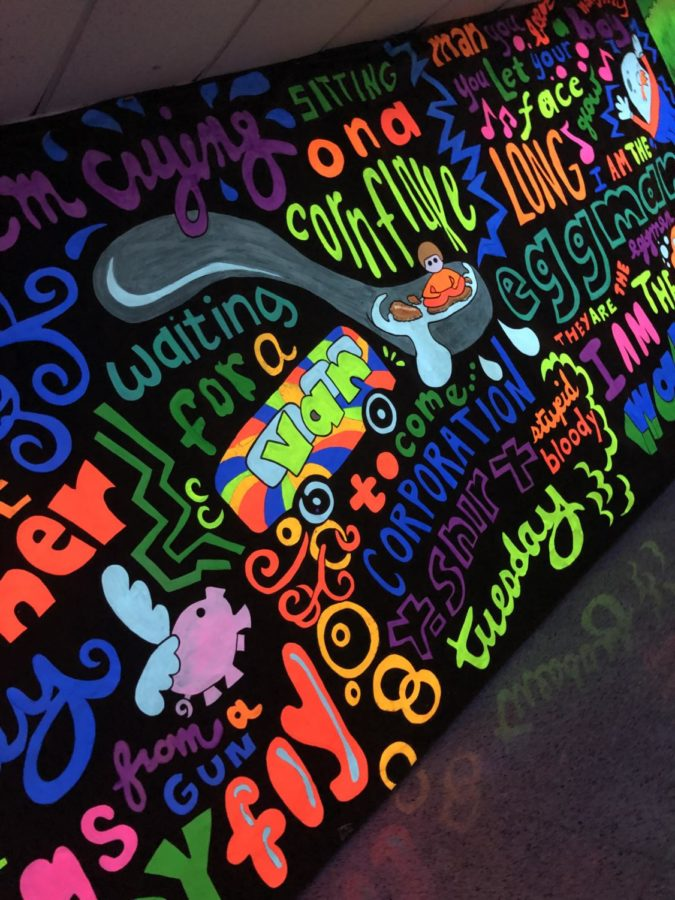 """One of the Beatles themed murals was in the """"blacklight hallway""""."""