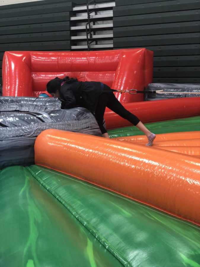 Isha Shah, a junior, participates in a game of Hungry Hungry Hippos.