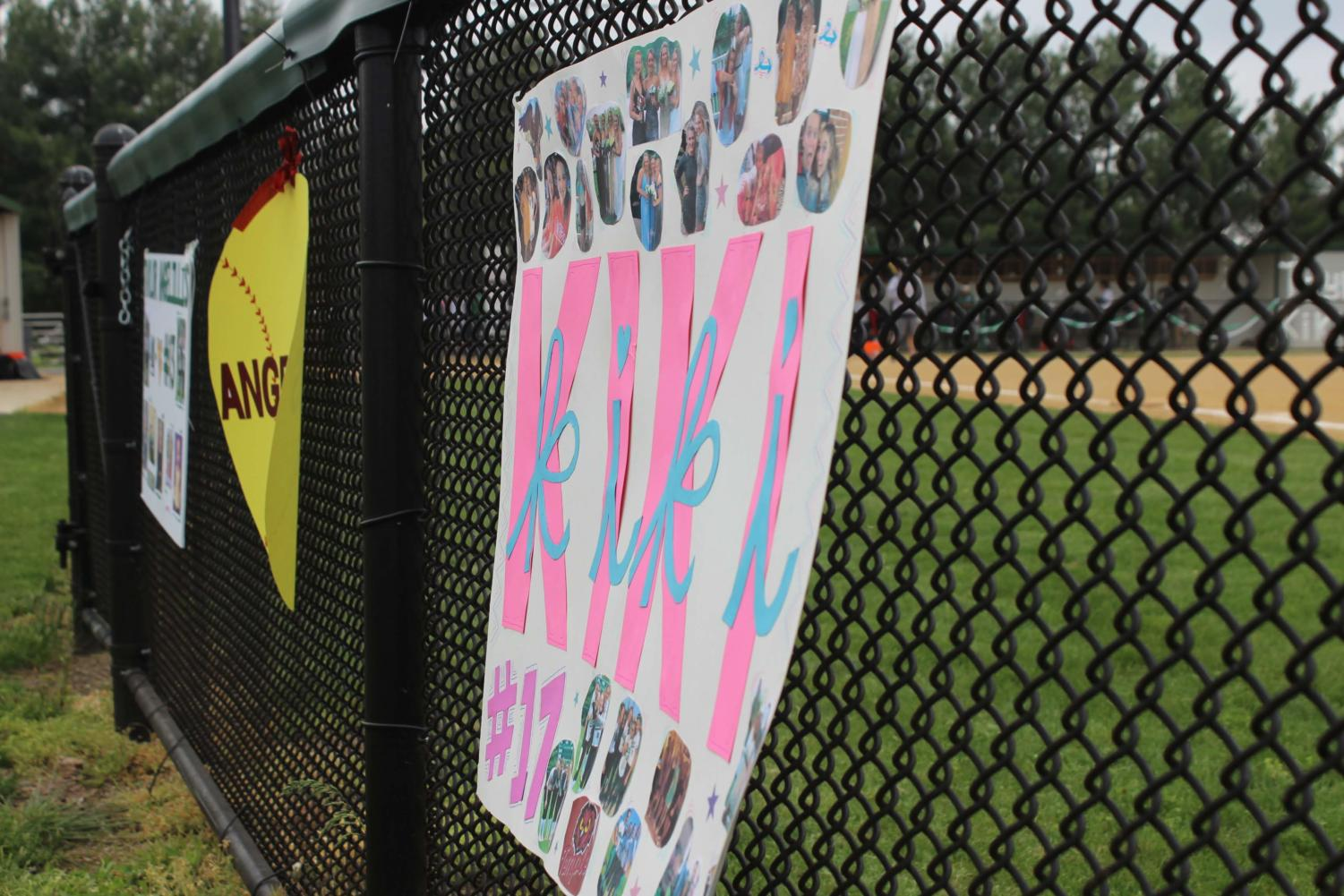 The+varsity+field+fence+was+adorned+with+posters+to+celebrate+the+graduating+seniors.%0A