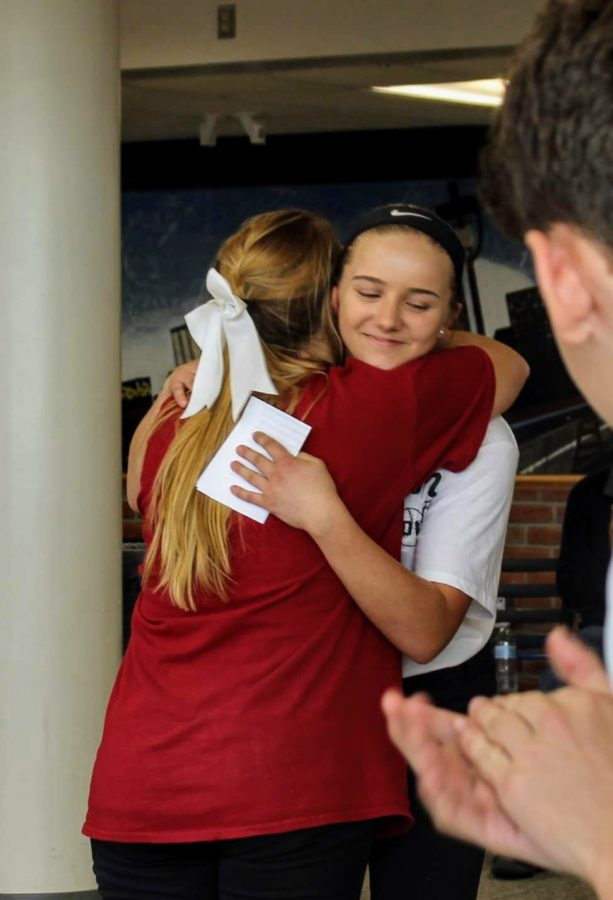 Olivia Terry (sophomore), hugs Kiki Hamilton, a senior, after delivering a graduation speech.