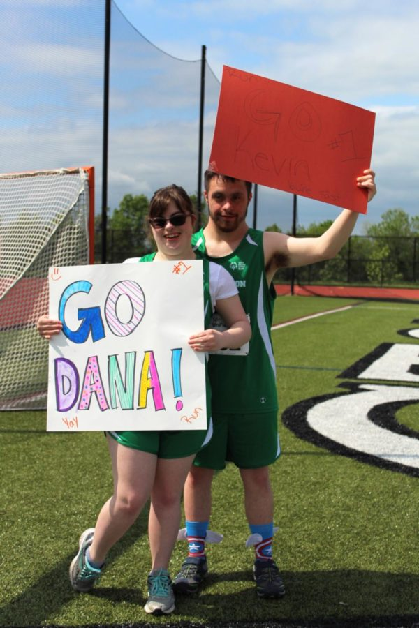 Seniors Dana Meoli and Kevin DiSanto pose together with their posters.