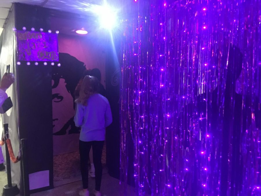 Freshmen visitors enter the decorated Prince themed bathroom.