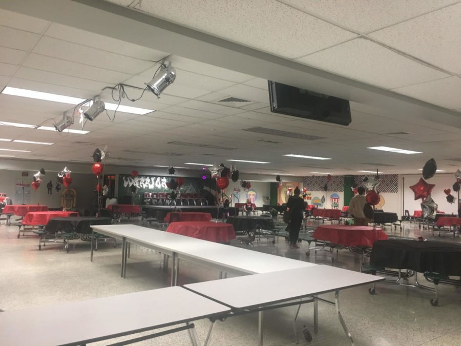 Workers and volunteers help set up the cafeteria before post prom begins.