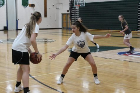The girls play a three on three game while Tori Bockrath and Nina martino practice their offensive and defensive skills.