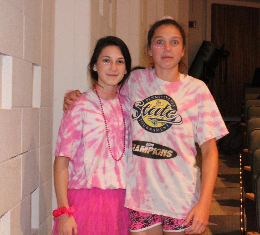 Freshmen Julia Reid and Avery Schwartz don their pink in study hall.
