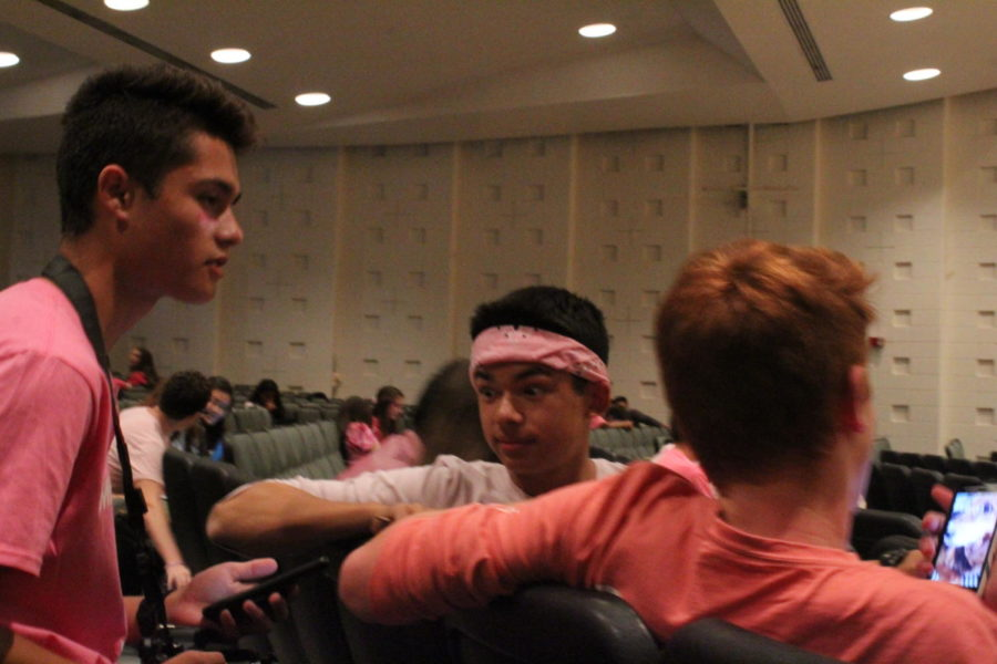 (from left) Sophomores Tristan Landsberg talks with Quinton Stemler  and Colin Yeh in study hall on Pink Out Day.