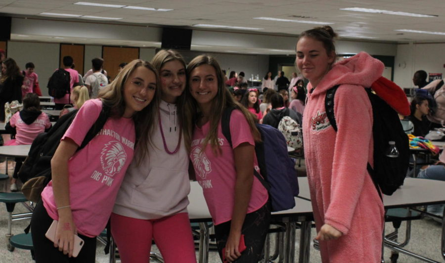 A+small+group+gathers+together+in+their+pink+prior+to+seventh+period.