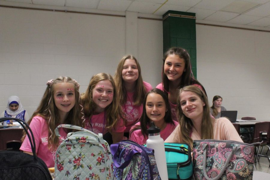 (from left) Isabelle Gerhart, Mandy Baldwin, Kendall Richardson, Riley McDonald, Gabby Baker, and Analiesa Geiling eat lunch while dressed in pink.