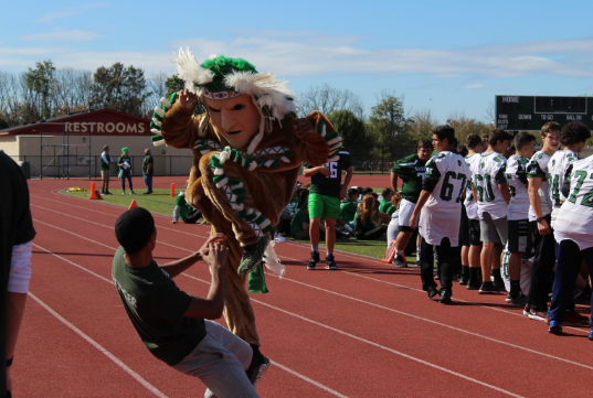 The Warrior mascot danced with a student while teams were announced.