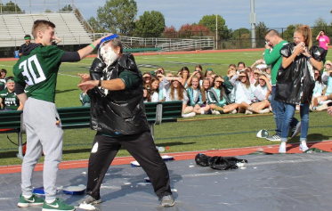 Nick DiSabatino coats Mr. Cardillo in a whipped cream pie to end the charity segment of the pep rally.