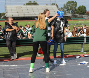 Sophomore Sarah Kenwood smashes a pie to face of math teacher Ms. Crist.