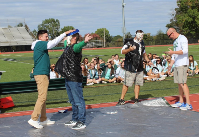 Mr. Chapin takes a pie to the face for charity at the annual pep rally.