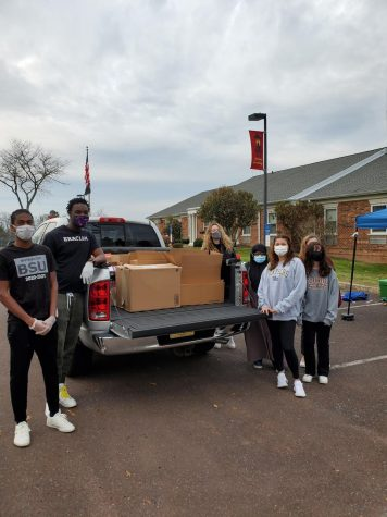 BSU members gather around food donations during their inaugural food drive on Nov. 21.