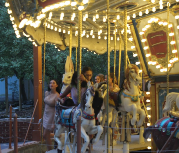 A number of students chose to ride the carousel during the evening.
