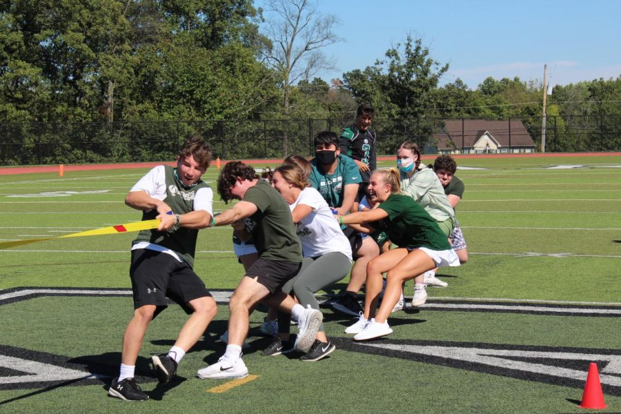 The seniors work hard to take down the junior class in tug-of-war.